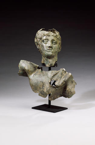 A Roman bronze fragmentary bust of a young man
