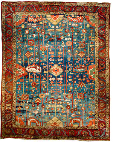 A Heriz carpet North West Persia, 12 ft 5 in x 10 ft 1 in (375 x 307 cm) some old moth damage