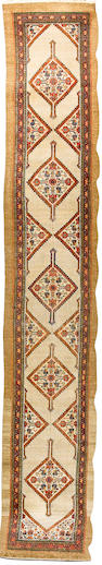 A long Sarab runner North West Persia, 19 ft 10 in x 3 ft 5 in (604 x 104 cm)