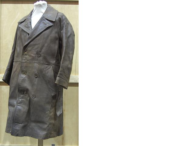 A gentleman's leather double-breasted lined motoring coat,