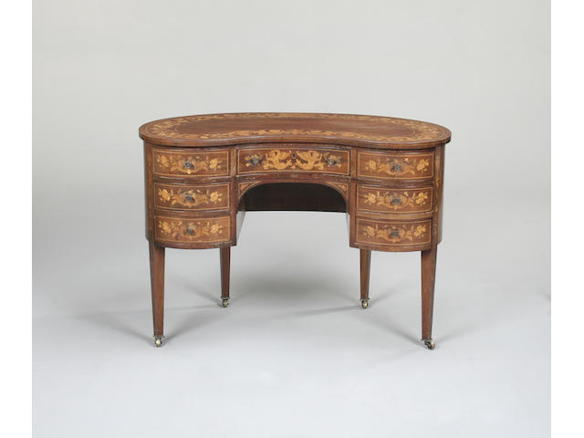 An early 20th century mahogany and marquetry kidney shaped dressing table