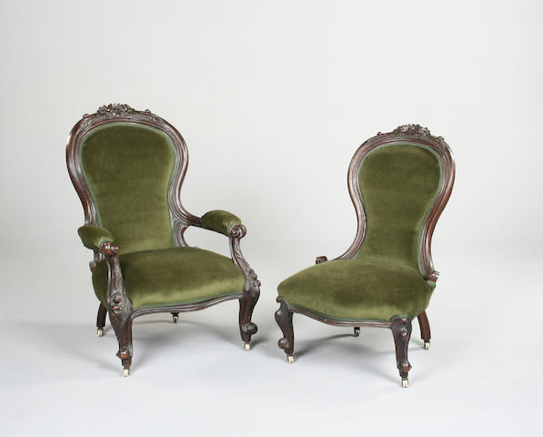 A pair of carved walnut fireside chairs