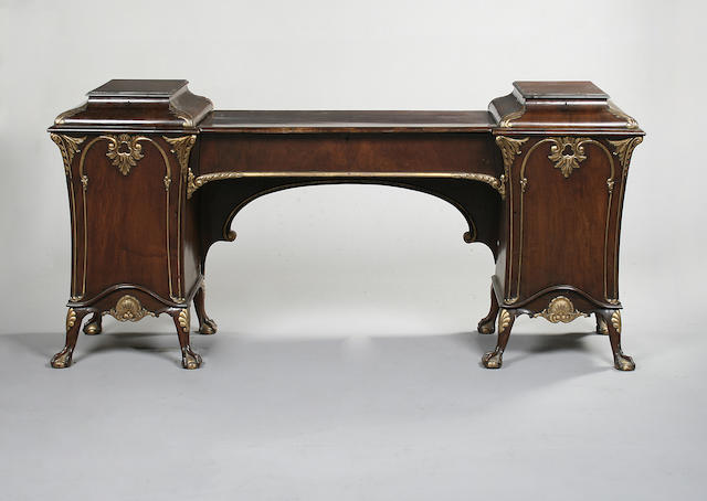 A late 19th century walnut and parcel gilt pedestal sideboard