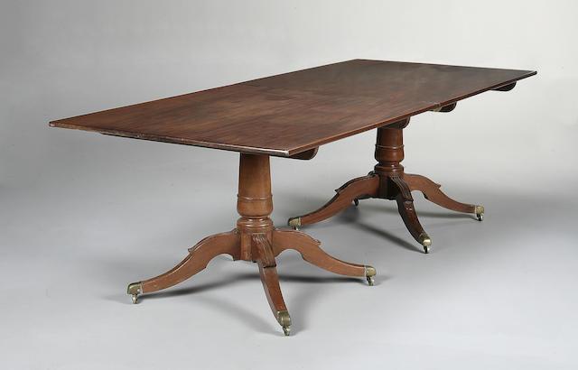 A 19th century mahogany twin pillar dining table