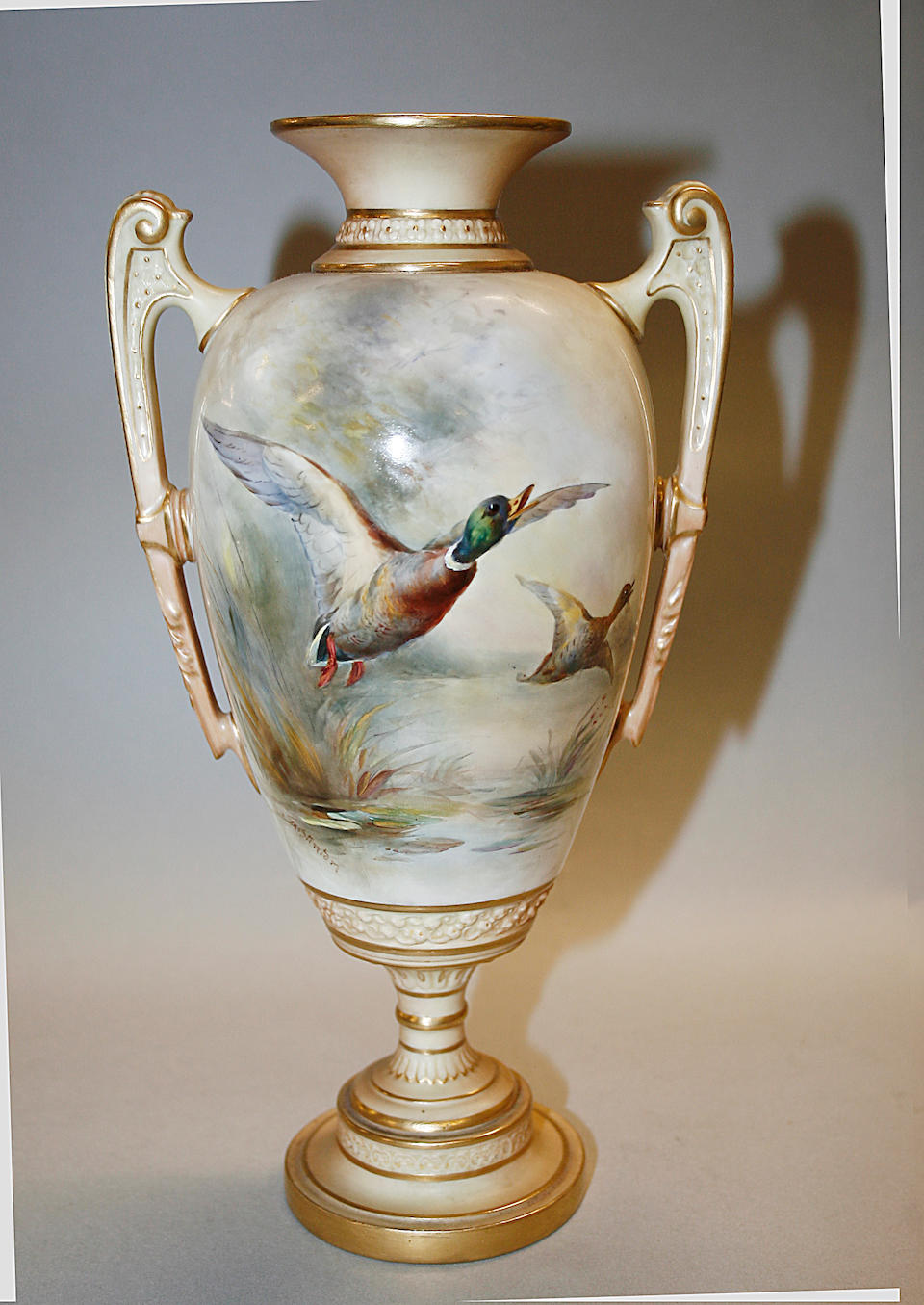A pair of Royal Worcester vases and covers by JAS Stinton dated 1910,