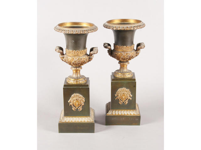 A good pair of Empire period gilt and 'verdigried' bronze urns on pedestals