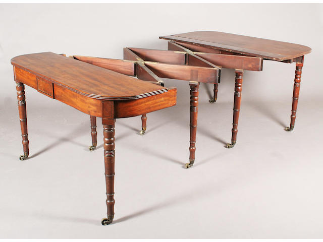 A late George III figured mahogany concertina action extending dining table
