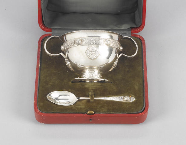 A cased silver  Celtic style two-handled porringer and spoon, by Philip Hanson Abbott, London 1914,