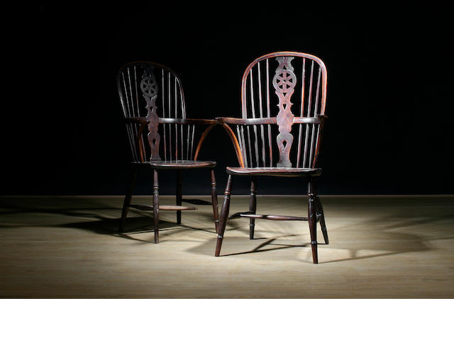 A pair of mid 19th Century yew wheel back high Windsor chairs