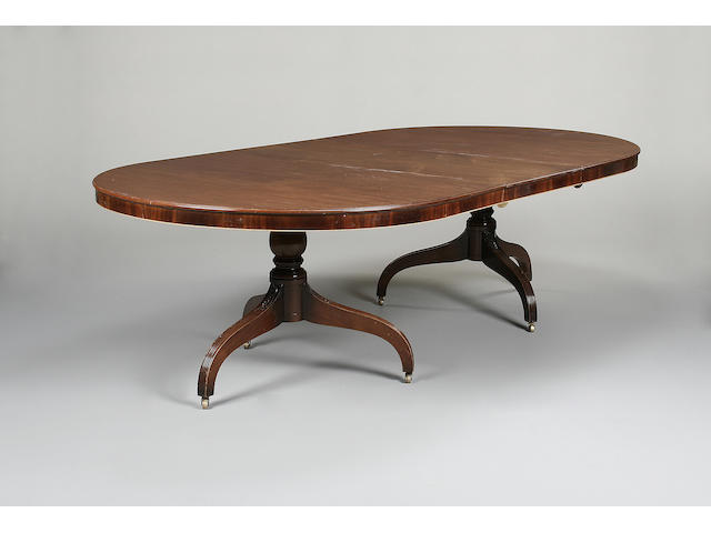 A 20th century mahogany twin pillar dining table