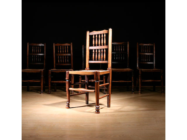 A harlequin set of six 19th Century ash spindleback dining chairs