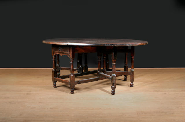 A late 17th/ early 18th Century oak large double action gateleg table