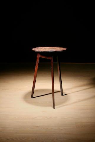 An early 19th Century oak cricket table