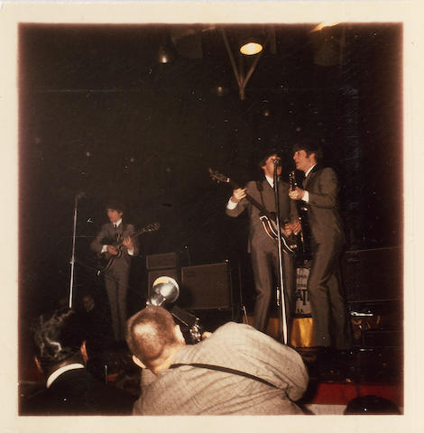 Photographs of the Beatles onstage at the Washington Coliseum, Washington DC, 11th February 1964,