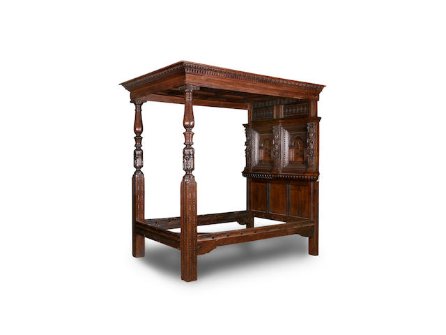 An 18th century and later tester bed.