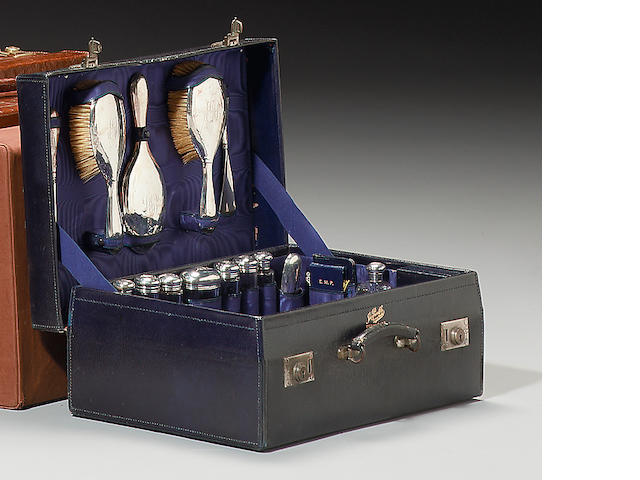 An early 20th century blue leather suitcase with silver fitments, by John Pound & Co, the silver fitments Birmingham 1906-1911,