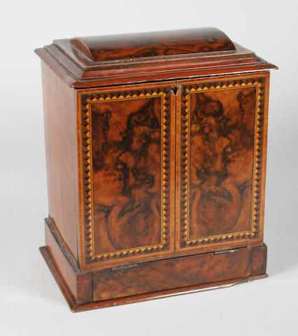 A Victorian burr and figured walnut desk top writing cabinet