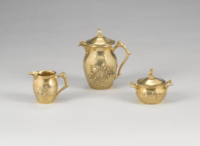 A late 19th century German silver-gilt three piece coffee service, in the Tiffany Japanesque martele