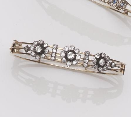 A late Victorian diamond set hinged bangle, circa 1890