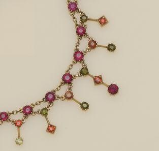 An Edwardian vari-coloured garnet fringe necklace