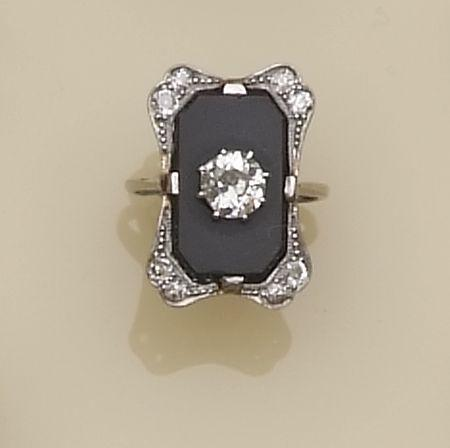 A diamond and onyx set panel ring