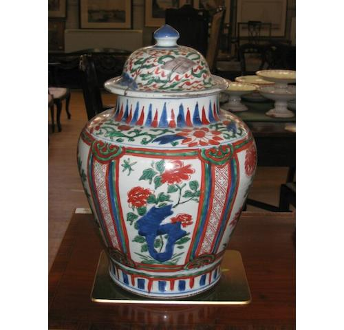 A Chinese baluster jar and cover, painted in Imari colours, and an Edwardian rose decorated six piece toilet set.