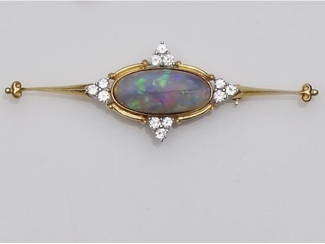 An opal and white paste cluster pendant,