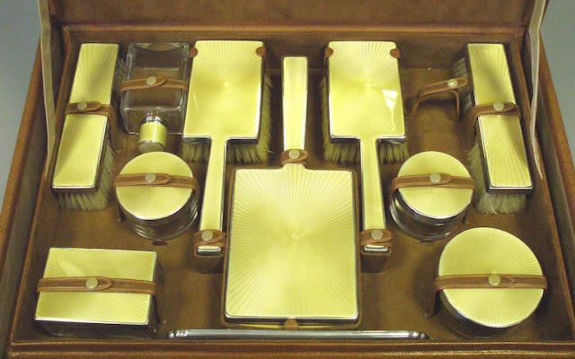 A ten piece silver and enamel dressing set, by Goldsmiths & Silversmiths, London 1947/48,