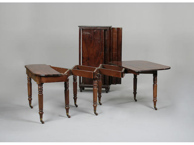 A late Regency mahogany concetina action dining table
