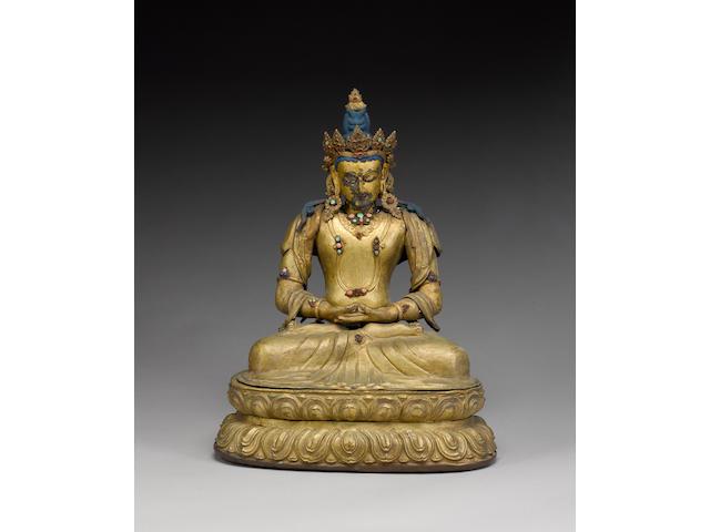 A Tibetan or Himalayan gilt-metal figure of a Deity;
