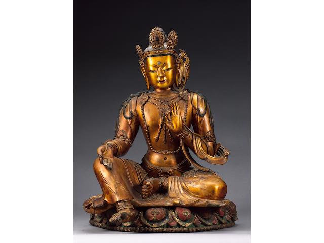 A Sino-Tibetan carved giltwood Deity,