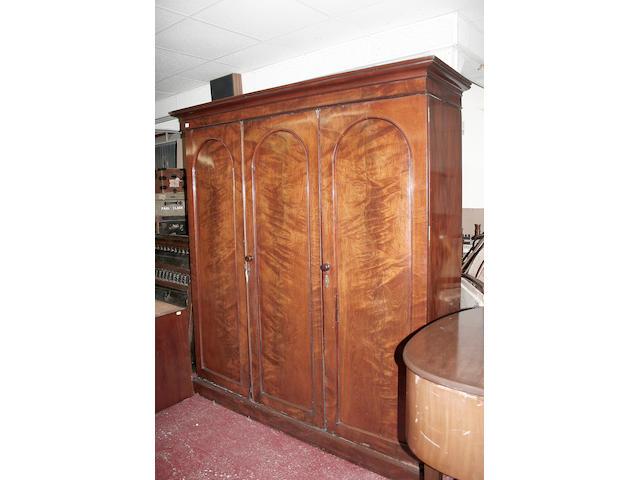 A mid Victorian mahogany triple wardrobe