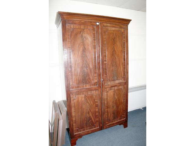A large George III mahogany double door wardrobe