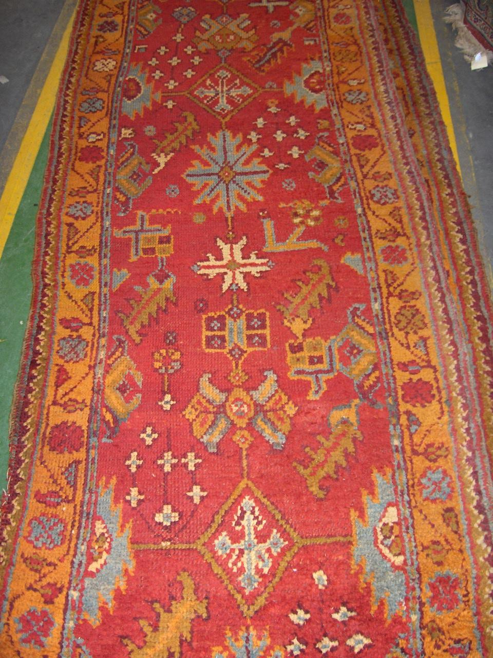 An Ushak runner West Anatolia, each measuring approx 364cm x 83cm together with two other similar runners (3)