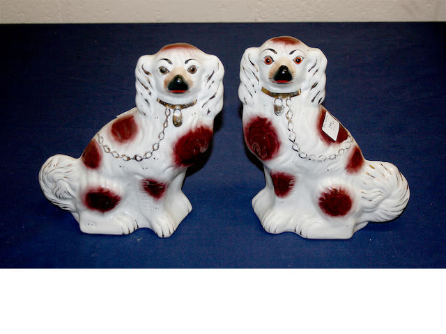 A pair of Staffordshire comforter spaniels