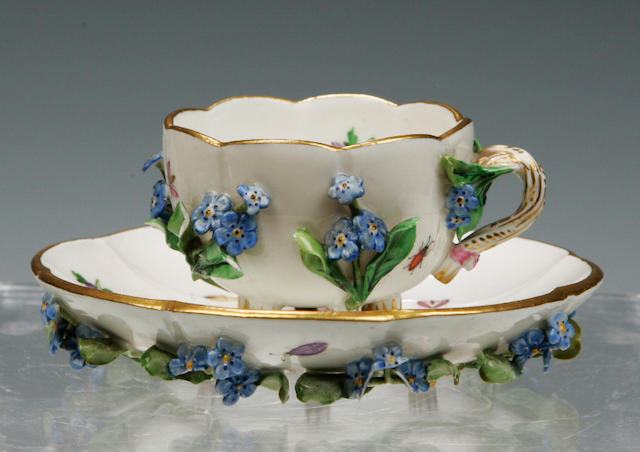 A Meissen floral encrusted cup and saucer 19th century