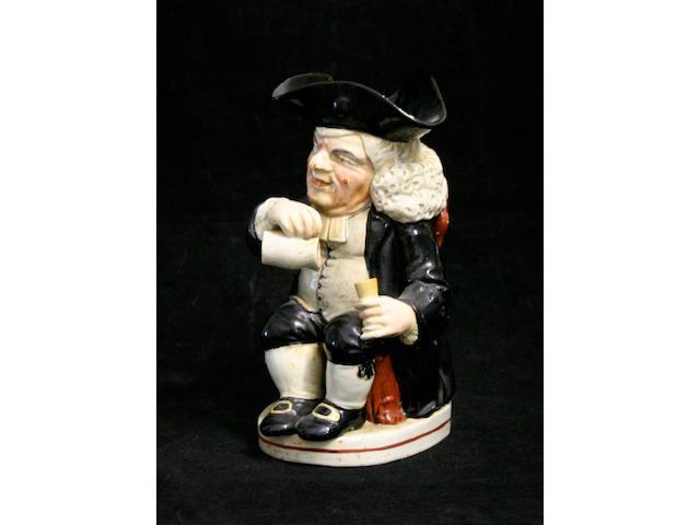 A 'Drunken Parson' Toby jug, circa 1820-30