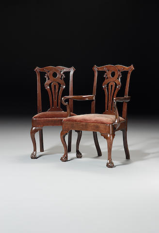 A set of eight George II mahogany Dining Chairs including a pair of Open Armchairs