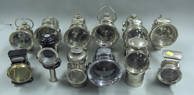 A good lot of early bicycle lamps,