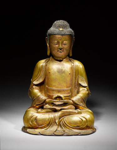 A large gilt-bronze seated figure of Buddha 16th/early 17th century