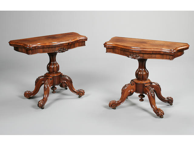 A pair of early Victorian rosewood serpentine card tables