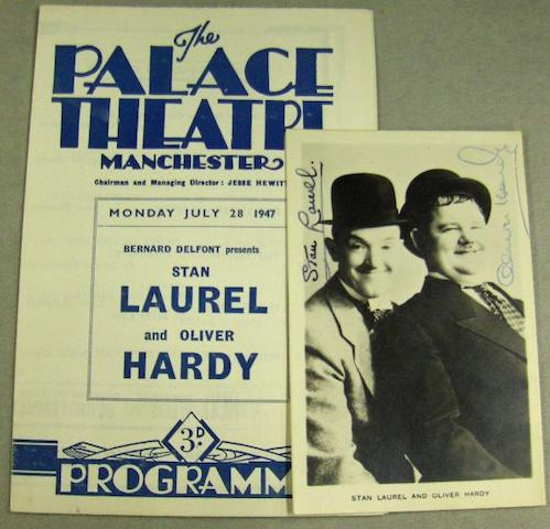 A Laurel and Hardy autographed promotional postcard, together with corresponding Laurel and Hardy performance programme,