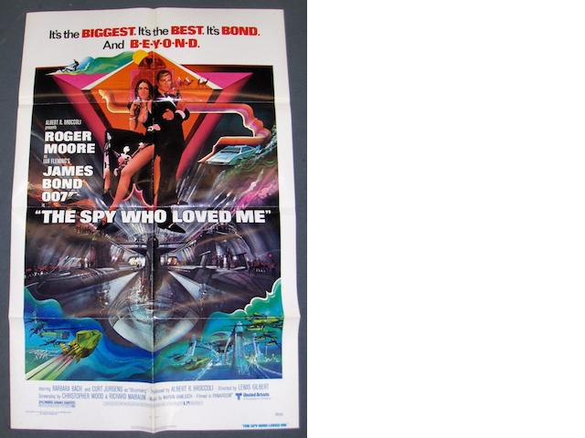 A collection of four James Bond related posters, 1977-1985, comprising: