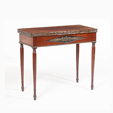An early 19th century figured mahogany fold-over card table