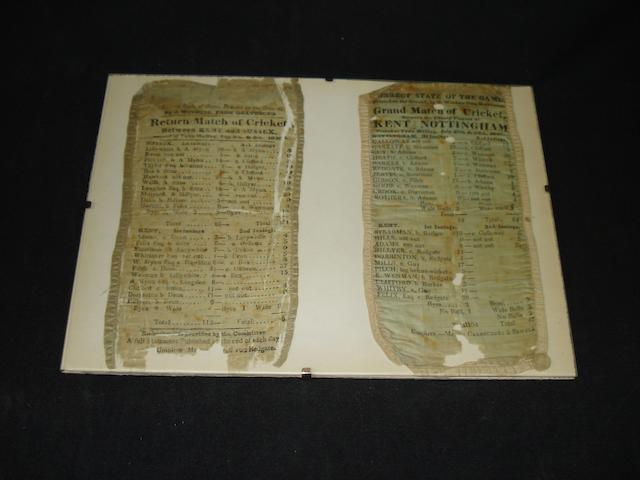 Two silk cricket scorecards