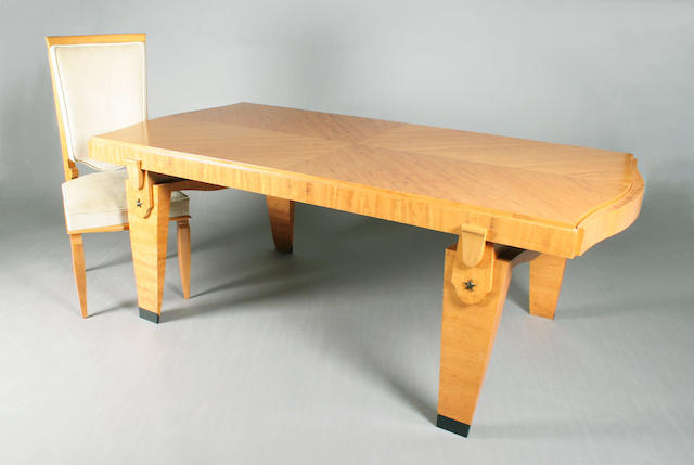 A French Art Deco period satinwood veneered and beech dining table in the style of Andre Arbus