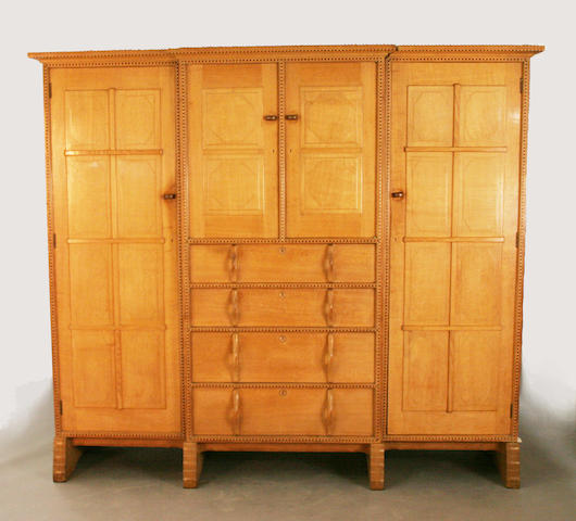 A good golden oak compactum wardrobe by Peter Waals, circa 1926, after a design by Ernest Gimson