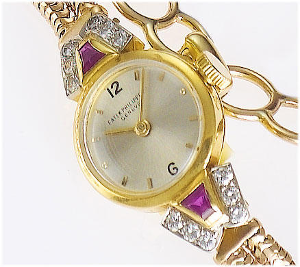 Patek Philippe. An 18ct gold diamond and ruby set ladies bracelet watch   Case No.509384, Movement No.866011, 1949