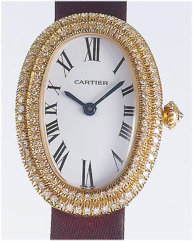 Cartier. A lady's 18ct gold diamond set wristwatch1990's