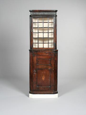 An oak corner cabinet,